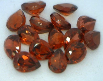 One Red Spessartite Garnet Accent VS Gem 4x3 mm Faceted Pear Average .23 carat
