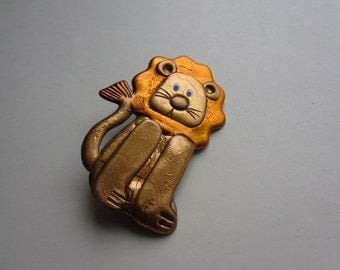 Whimsical lion pin brooch