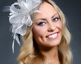 White fascinator for weddings, Ascot, Derby. Gorgeous white fascinator hat with feathers and veil