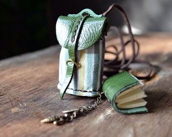 Necklace MiniatureBook in a little bag green color.