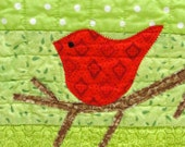 red bird mini wall quilt- red bird on bare branch against a background of green for Christmas and winter