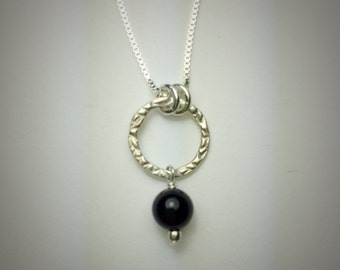 Sterling silver small circle necklace with onyx