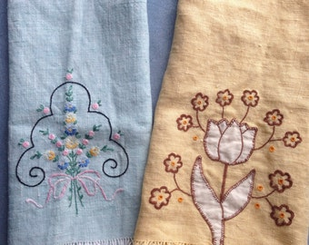 Two embroidered tea towels