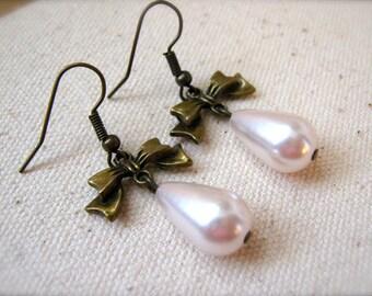 Earrings Brass Bow Earrings. Pearl Tear Drop Earrings. Bow Charm Earrings. Pear Drop Earrings. Ivory Pearl Dangle Earrings. White Earrings.