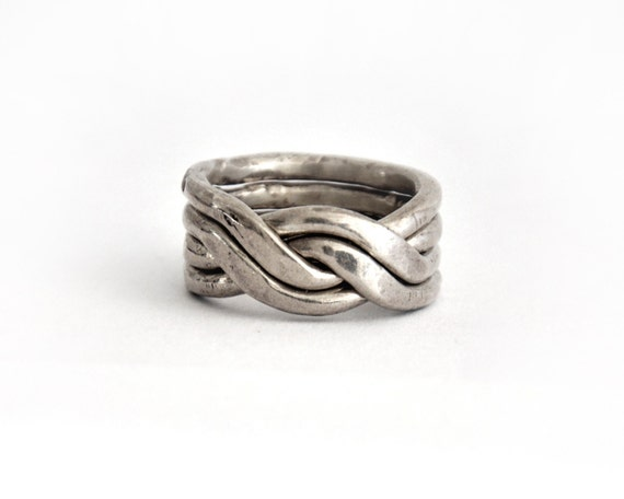 Double twist || 4 piece puzzle ring || Sterling silver || Modern chique || Unisex || High-end jewelry || Made in Israel || A great gift idea