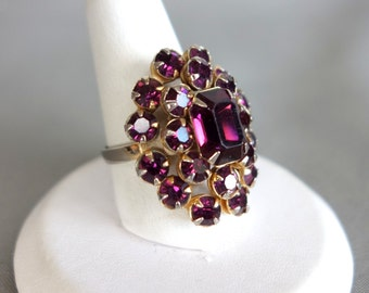 Vintage adjustable gold tone cocktail ring with purple rhinestones
