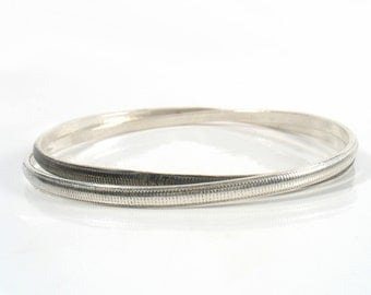 Interlace sterling silver bangles. Sterling Silver Rolling Bangle Bracelet-2 interlocking bangles