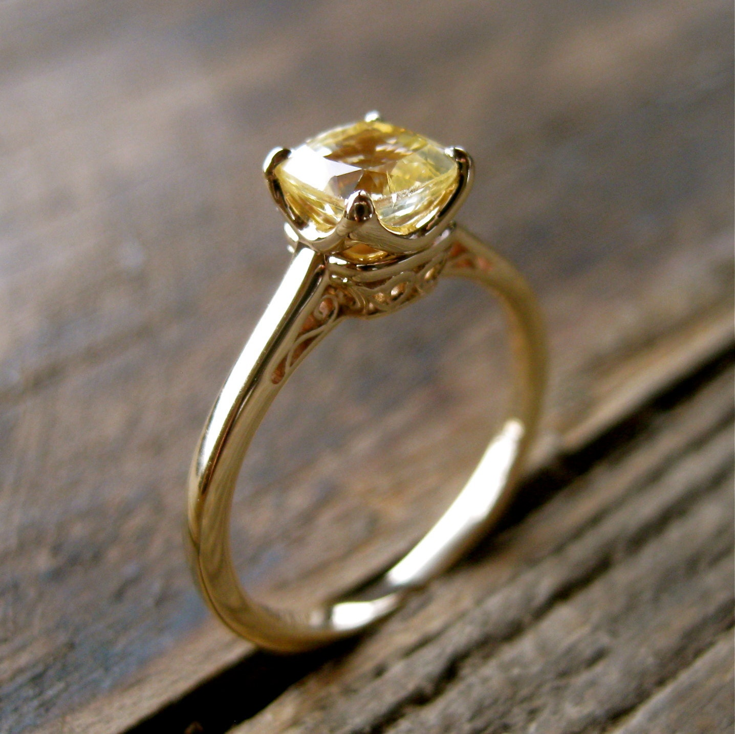 cushion cut yellow sapphire engagement ring in 14k yellow gold