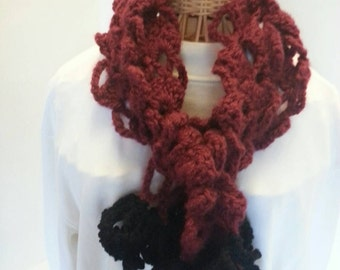 Deep red crocheted lace scarf with black ruffle fringe