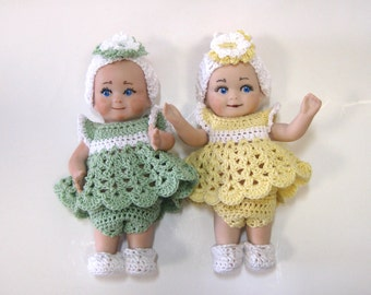 "Cupie/kewpie 5"" full porcelain dolls with movable arms cast from a vintage mold and dressed in crocheted dresses"