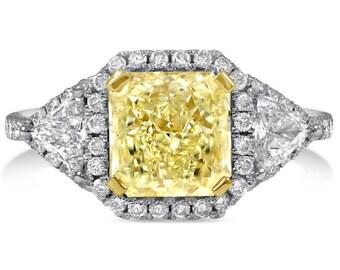 Radiant cut light fancy yellow engagement ring wtih triangle & round cut diamonds RADFY201