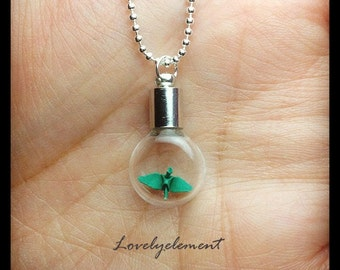 miniatures smallest origami crane necklace, flat round glass vial