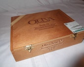Nice solid wood Oliva cigar box with hinged lid and brass hardware