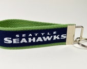 Seattle Seahawks fabric key fob keychain wristlet, blue and white with green webbing