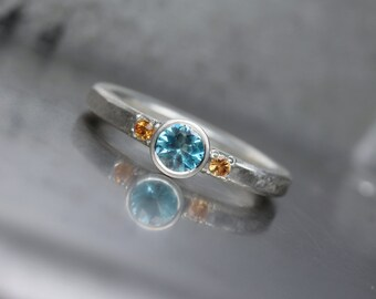 Blue Zircon Orange Sapphire Engagement Ring Hammered Textured Silver Water Sun Beach Ocean Romantic Sunset Bridal Band Hers - Wasserglanz