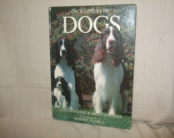 The Encyclopedia of Dogs by Claudia Long & Britt Strader