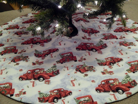 Nostalgic old red truck in the snow christmas tree skirt