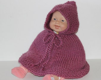 Hand knit baby cape. Mauve wool. Girl's poncho with hood. Newborn to 18 months.  Baby Shower gift.  Baby car seat wrap. Handmade. Photo Prop