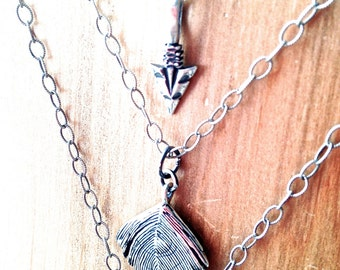 Sterling Silver Triple Strand Necklace with Feather, Arrowhead, and Cross Pendants