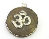 Tibetan amber copal resin Om mantra pendant with reverse deer filigree - PM292A