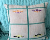 Vintage Thunderbird embroidered fabric turned into a pillow
