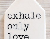 porcelain tag screenprinted text exhale only love. -rumi