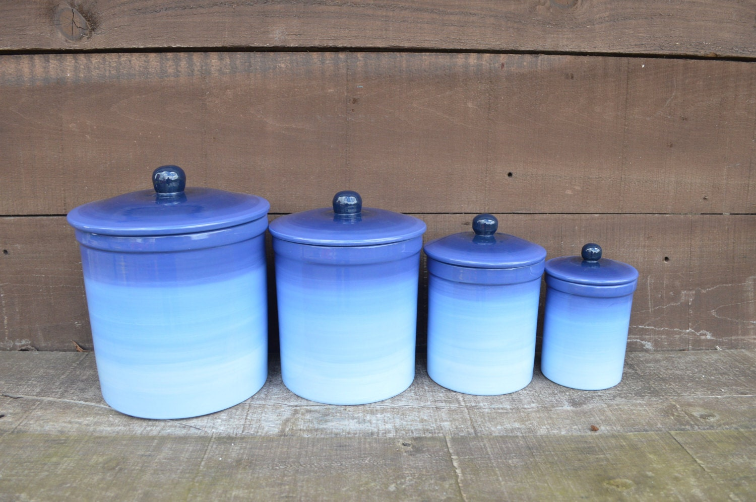 one of a kind set of 4 blue ombre ceramic canister set with. Black Bedroom Furniture Sets. Home Design Ideas