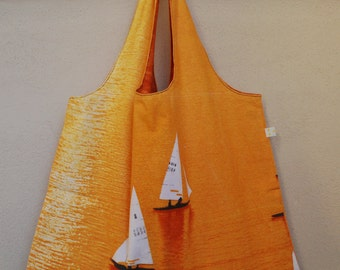 Reversible orange tote with sailboats