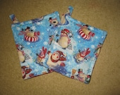 An Adorable set of Quilted Snowman and Snowflake Pot Holders