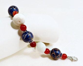 Royal Blue, Gold, and White Lampwork Beads, White Sponge Coral, & Orange Banded Agate Bracelet