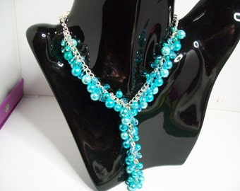 Turquoise glass pearl and glass facet Y necklace