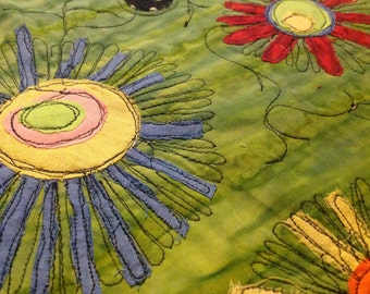 Art pillow case green batik, appliqué flowers and dots