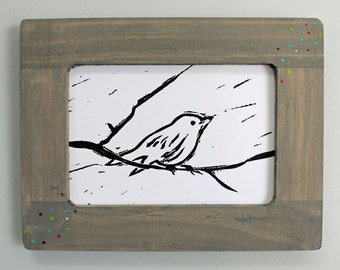 Linocut Print of a Bird on a Branch
