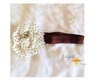 Brown headband with flower clip.