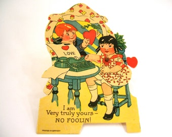 Antique Valentine card typing love note, typewriter, metal mechanical pivot arm heart diecut, red green blue 1920s paper ephemera, Germany