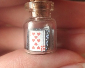 Miniature playing cards in a bottle, 52 tiny handmade cards in a tiny corked bottle