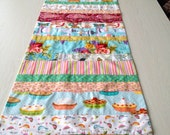 Table runner, hand  pieced, using eleven fabrics, 18X65 inches, featuring Michael Miller and Amy Butler fabrics