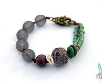 Peacock going wild - unique handmade bracelet in purple and green with artisan beads
