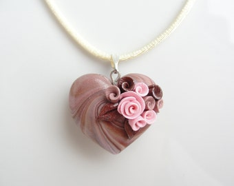 Heart necklace in caramel and pink colours with rose detail handmade from polymer clay