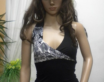 Elegant ladies' top combination of black and white with naked back