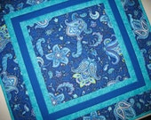 Floral Table Topper in shades of blue, quilted Fabric from Timeless Treasures Belize line