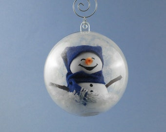Ornament: Wooden Snowman in Frosted Globe with Blue Floppy Hat and Scarf