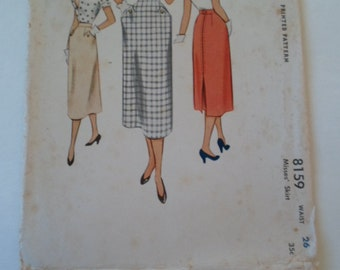 Vintage  1950s Mc Call below the knee skirt with back pleat and retro pockets  sewing pattern