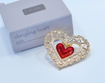 Vintage 1991 Avon Dangling Heart Goldtone Poured Red Enamel Open Work Scroll Gold Tone Brooch Pin in Original Box NIB
