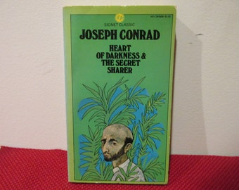 a review of joseph conrads book the secret sharer and heart of darkness