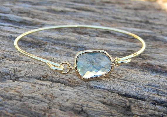 gold bagle bracelet with stone