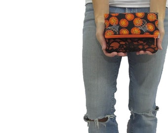 basketball clutch. ready to ship and on sale fold over style pouch. Basketball fabric with black lace and orange.