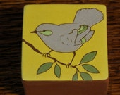Ceramic bird art block- perfect for sitting on a window sill or book case, or hanging on the wall.