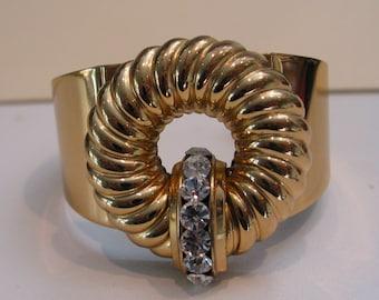 Vintage Art Deco CORO wide  cuff bracelet in gold tone with rhinestones
