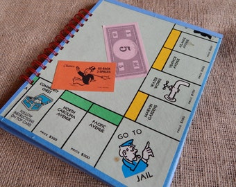 Recycled Monopoly guest book, notebook or scrapbook, large sized board game book with card stock pages